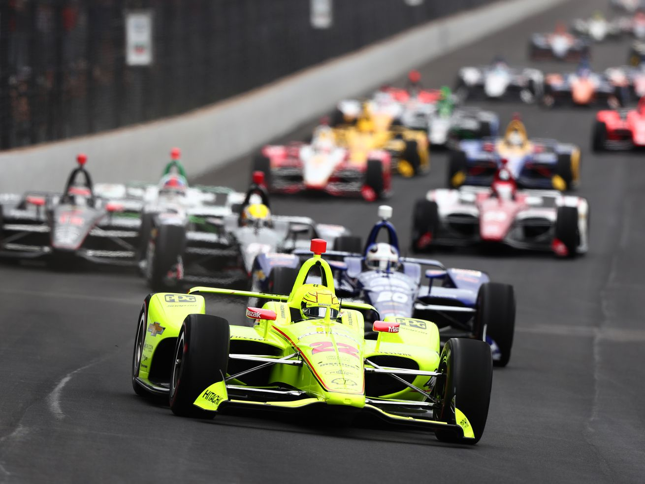 Simon Pagenaud of France, driver of the #22 Team Penske Chevrolet, leads the field at the start of the 103rd Indianapolis 500.