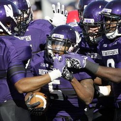 Northwestern running back Venric Mark (5) celebrates a touchdown with teammates during the first half of an NCAA college football game against South Dakota in Evanston, Ill., Saturday, Sept. 22, 2012.