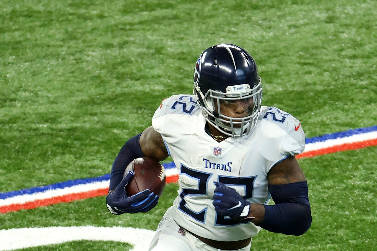 Derrick Henry #22 of the Tennessee Titans takes the ball in for a touchdown in the first quarter during their game against the Indianapolis Colts at Lucas Oil Stadium on November 29, 2020 in Indianapolis, Indiana.