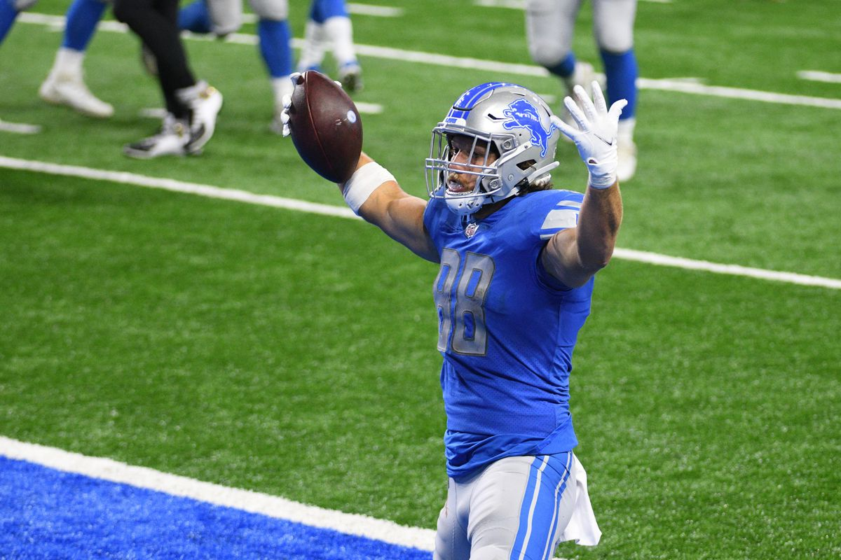Detroit Lions tight end T.J. Hockenson celebrates after scoring a touchdown against the New Orleans Saints during the third quarter at Ford Field
