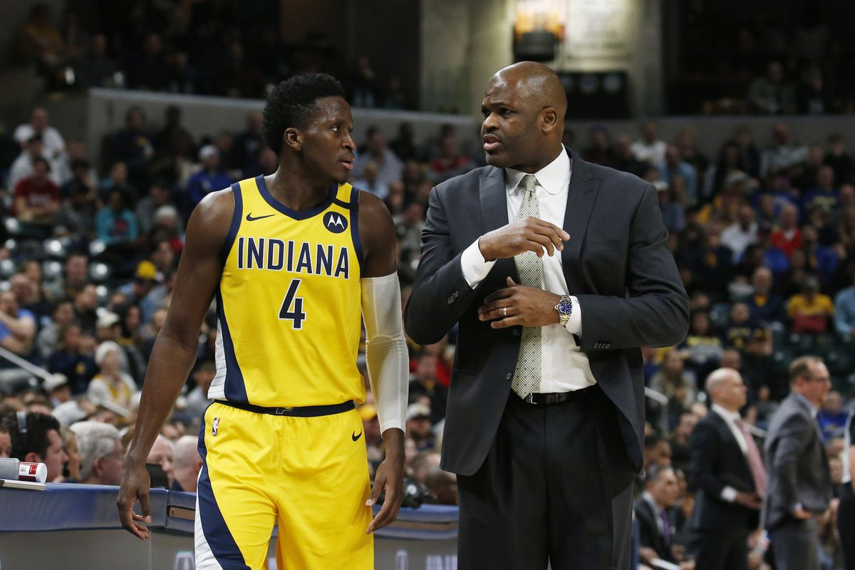 Indiana Pacers coach Nate McMillan talks with guard Victor Oladipo in a game against the Toronto Raptors during the first quarter at Bankers Life Fieldhouse.