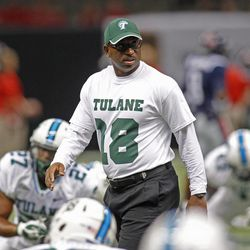 Tulane head coach Curtis Johnson wears the number 18, honoring Tulane safety Devon Walker, who fractured his spine in a game against Tulsa on Sept. 8, before an NCAA college football game against Mississippi in New Orleans, Saturday, Sept. 22, 2012.