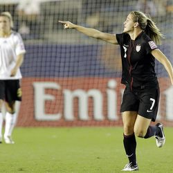 Kealia Ohai, right, of the United States reacts after she scored a goal during final match of the U20  Women's World Cup against Germany in Tokyo, Saturday, Sept. 8, 2012. (AP Photo/Koji Sasahara)