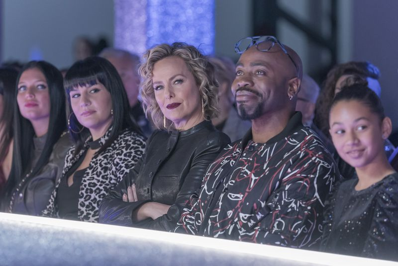 Scarlet editor-in-chief Jacqueline Carlyle (Melora Hardin) and fashion editor Oliver Grayson (Stephen Conrad Moore) watch Sutton's designs strut down the runway.