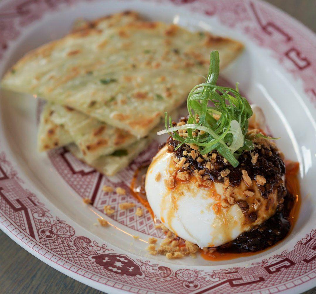 Scallion pancakes and creamy burrata topped with hot Sichuan chili sauce at Graffiti Bao