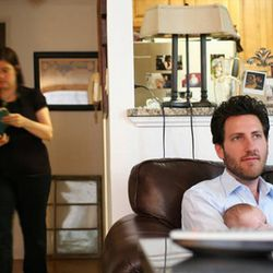 """<b>Alex Guarnaschelli</b>: Here we see a candid moment in the Guarnaschelli household, where husband Brandon watches over baby Ava, while Alex looks up things to do on her """"day off.""""  <i>[<a href=""""http://newyork.metromix.com/restaurants/essay_ph"""