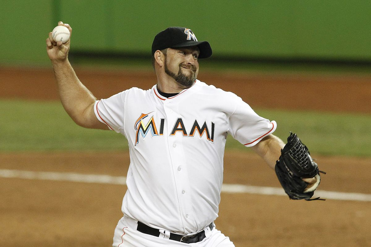 May 22, 2012; Miami, FL, USA; Miami Marlins relief pitcher Heath Bell (21) gets a save against the Colorado Rockies at Marlins Park. The Marlins defeated the Rockies 7-6.Mandatory Credit: Robert Mayer-US PRESSWIRE