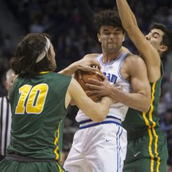 Brigham Young Cougars guard Elijah Bryant (3) fights for control of the ball against San Francisco Dons forward Matt McCarthy (10) and guard Jordan Ratinho (25) during BYU's 75-73 overtime win at the Marriott Center in Provo on Saturday, Feb. 10, 2018.