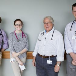 Dr. Anthony Zabel, left, Ninah Clegg, Dr. Gerold Butler and Dr. Ryan Taylor pose for a photo Thursday, April 28, 2016, at Franciscan St. Francis Hospital in Indianapolis. Butler is a pediatric hospitalist. Zabel and Taylor are pediatric residents. Clegg is a third-year medical student at Marian University.