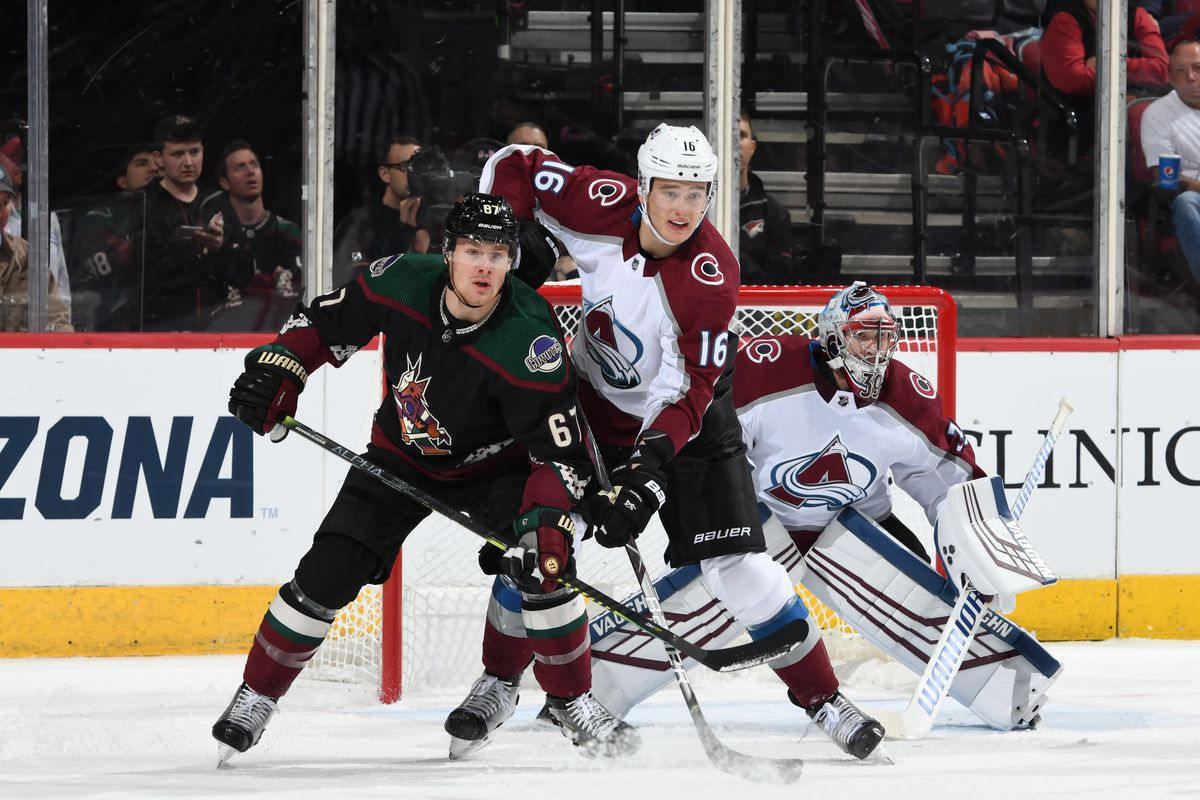 Lawson Crouse of the Arizona Coyotes battles for position with Nikita Zadorov of the Colorado Avalanche in front of goalie Pavel Francouz at Gila River Arena on November 02, 2019 in Glendale, Arizona.