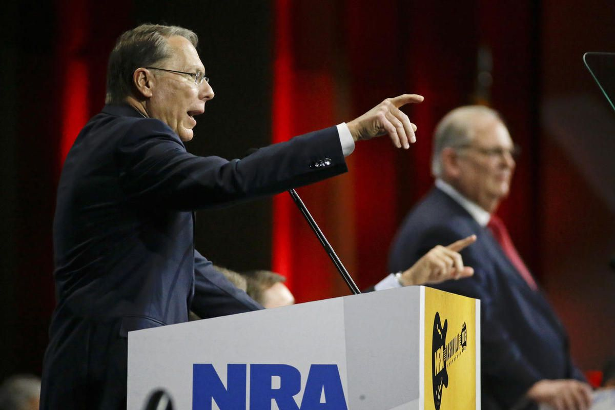Wayne LaPierre, left, executive vice president of the National Rifle Association, speaks during the annual meeting of members at the NRA convention Saturday, April 11, 2015, in Nashville, Tenn. At right is Jim Porter, NRA president.
