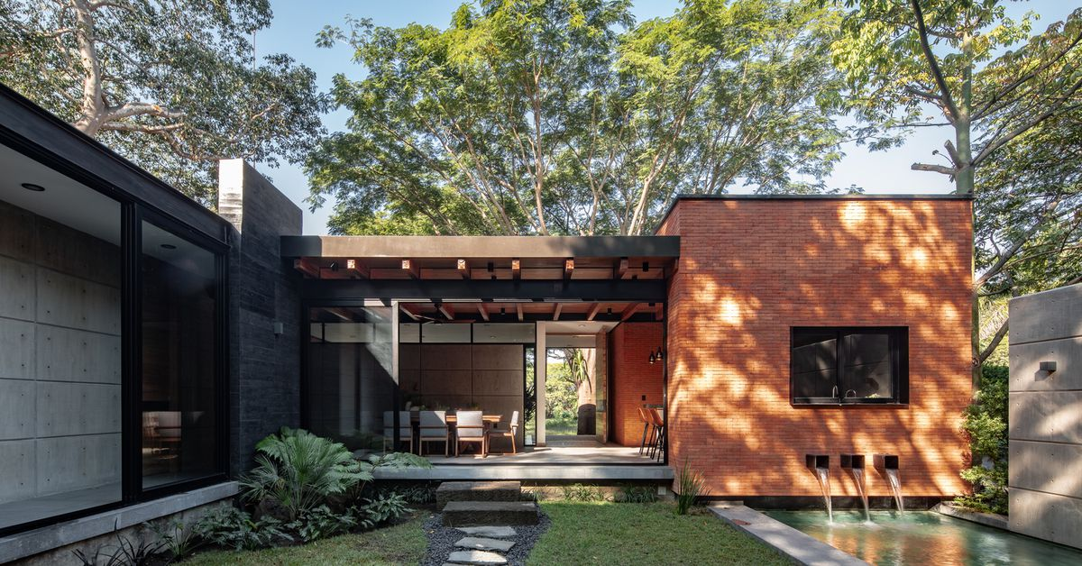 Indoor-outdoor home in Mexico wraps around a lush courtyard