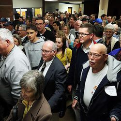 Crowds move through the halls during a Utah Republican caucus at Brighton High School in Salt Lake City on Tuesday, March 22, 2016.
