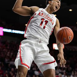 Arizona's Ira Lee (11) shouts after a big slam during the Arizona-Baylor game in McKale Center on December 15 in Tucson, Ariz. Lee finished the game with four points and five rebounds.