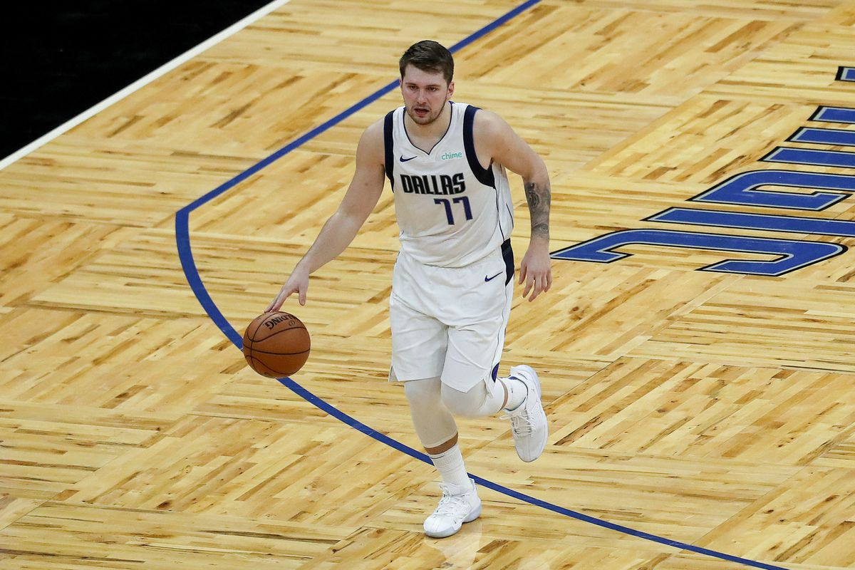 Luka Doncic of the Dallas Mavericks controls the ball against the Orlando Magic at Amway Center on March 1, 2021 in Orlando, Florida.