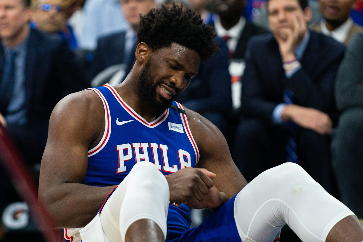 Philadelphia 76ers center Joel Embiid reacts after falling on his injured hand during the third quarter against the Oklahoma City Thunder at Wells Fargo Center.