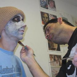 Bruce Evans, left, has zombie makeup applied by Angelo Rotondi, right at Morey's Piers in Wildwood N.J. on Sept. 27,2012. The boardwalk is adapting some of its summertime rides to a Halloween theme to try to extend the tourist season as long as possible.