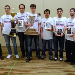 In this April 1, 2012, photo Texas Tech University coach Susan Polgar, right, and the Knight Raiders chess team pose with their trophy after winning the President's Cup tournament in Herndon, Va.  The Budapest-born coach and top players of the two-time national championship team are moving to Webster University in the St. Louis suburbs with a promise of a more substantial financial investment.