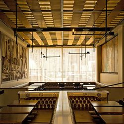 Copper plates on the ceiling help give the room an amber glow.