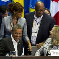 President Barack Obama, sitting left, and Secretary of State Hillary Rodham Clinton, sitting right, talks with U.S. Trade Representative Ron Kirk, top right, and an unidentified woman during the plenary session of the sixth Summit of the Americas in Cartagena, Colombia, Saturday April 14, 2012.