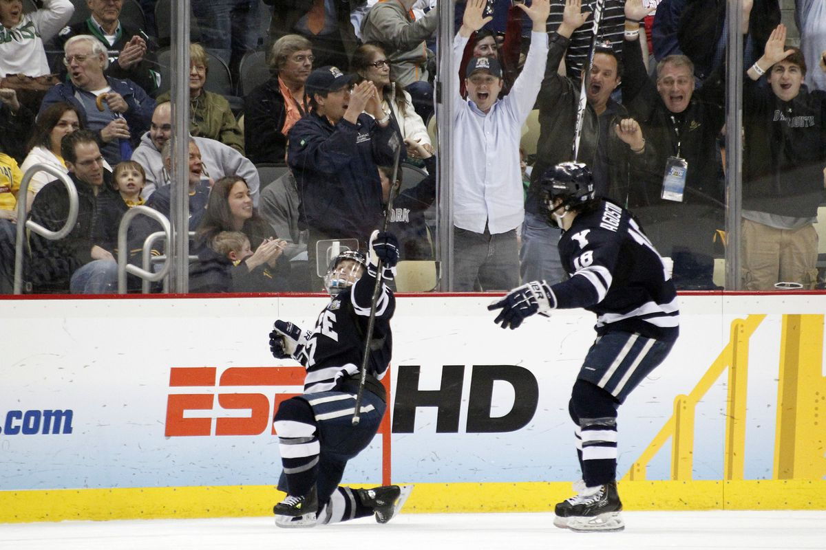 Yale's Andrew Miller celebrates his game winning goal in overtime.