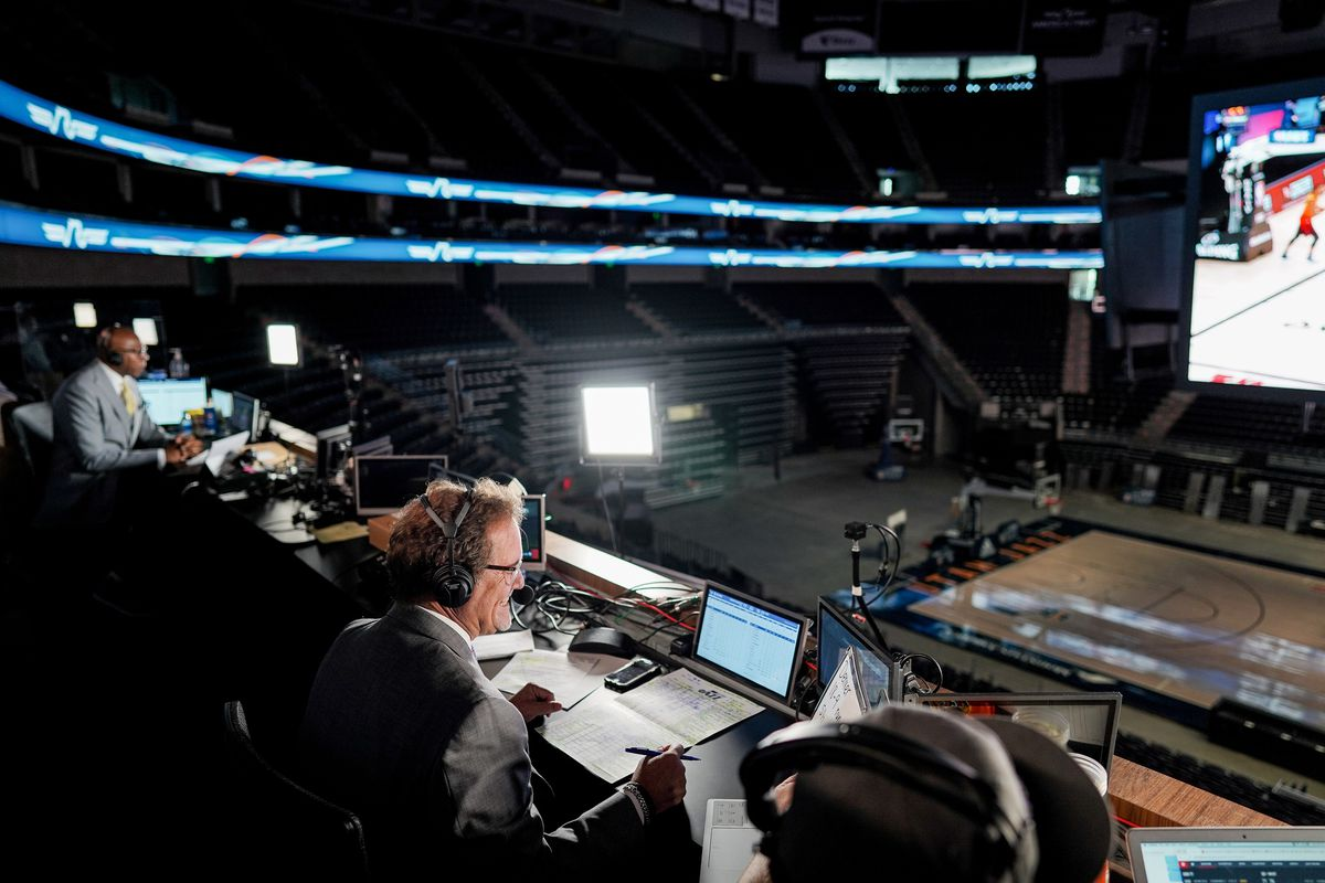 Craig Bolerjack, center, calls the play-by-play at Vivint Smart Home Arena in Salt Lake City as the Utah Jazz play the Denver Nuggets in the NBA bubble in Orlando, Fla., on Saturday, Aug. 8, 2020. At left, former Jazz player Thurl Bailey gives analysis while at right Tyson Ewing helps track stats.