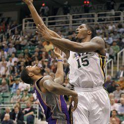 Utah's Derrick Favors shoots over the Sun's Markieff Morris as the Utah Jazz and the Phoenix Suns play NBA basketball Wednesday, April 4, 2012, in Salt Lake City, Utah.