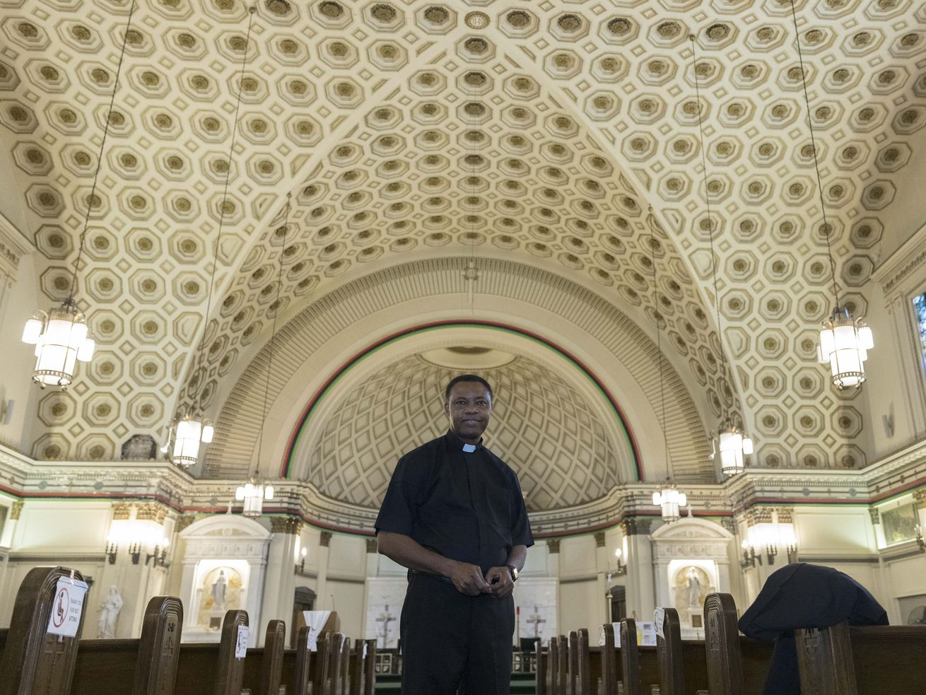 Father Edmund Nnadozie poses for a portrait inside Corpus Christi Church at 4920 South King Drive in Bronzeville, Thursday, June 10, 2021. | Anthony Vazquez/Sun-Times