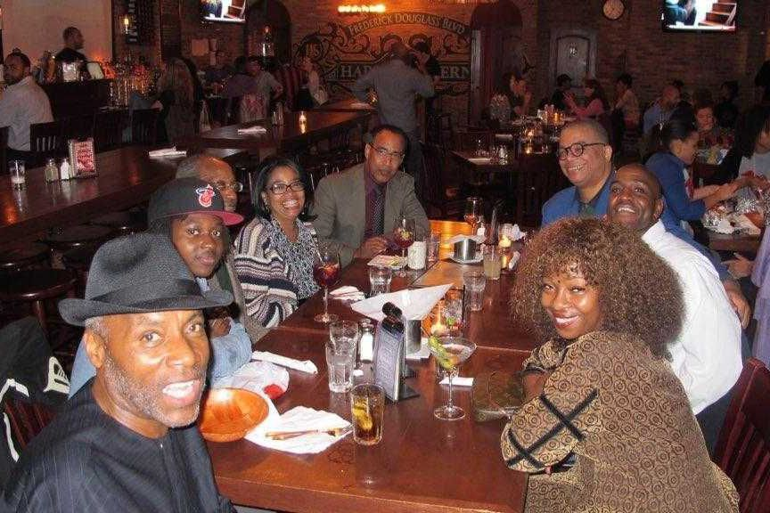 Councilmember Bill Perkins attended a dinner with his staff including Michael Henry Adams, top right in blue, in 2012.