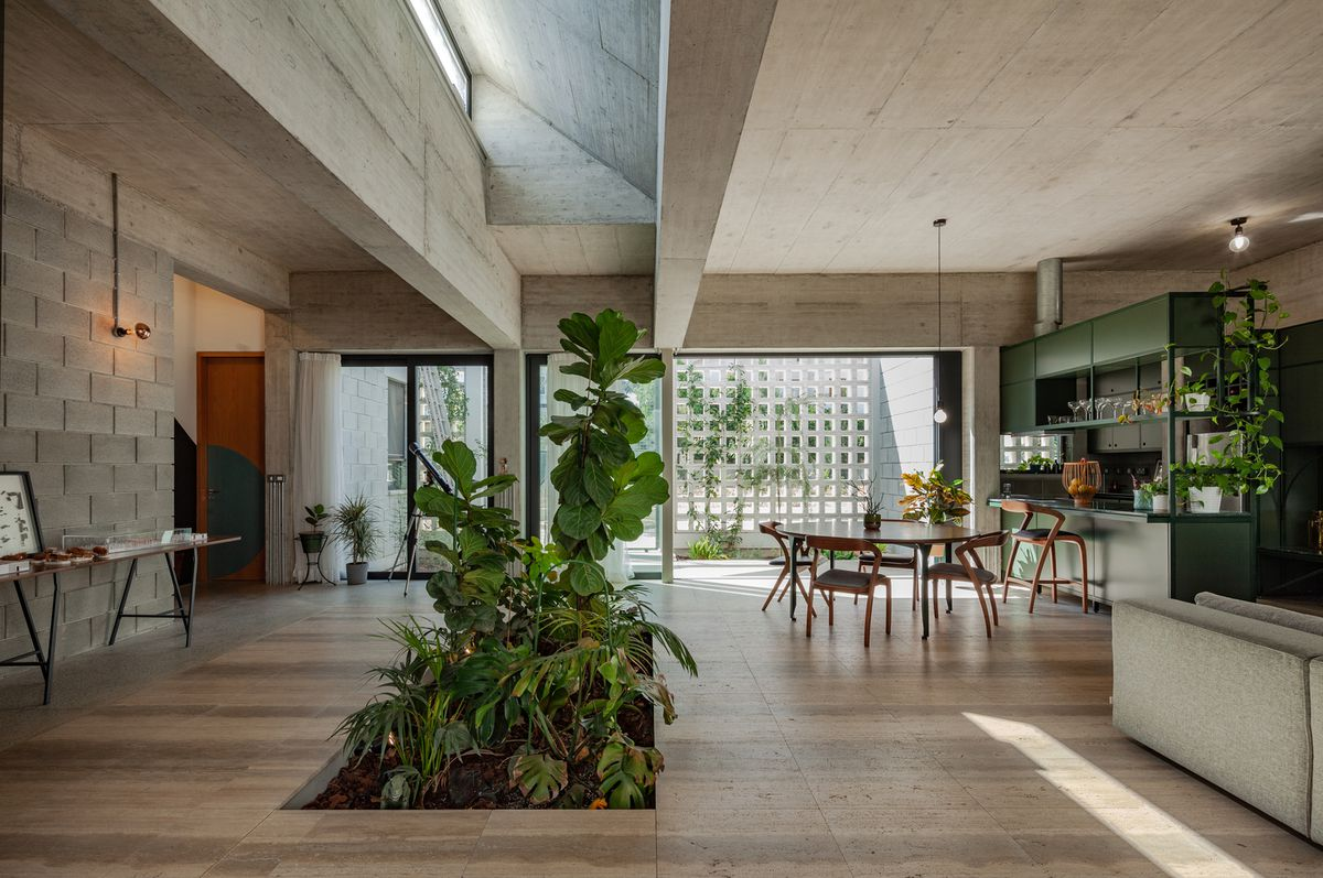 View of kitchen and dining area with a patch of indoor garden.