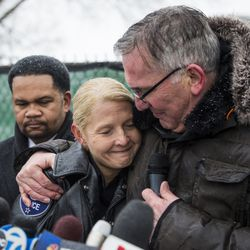 Aurora Police Chief Kristen Ziman hugs a chaplain as Mayor Richard Irvin looks on during a prayer vigil for the five people killed two days earlier in a mass shooting at the Henry Pratt Company, Sunday afternoon, Feb. 17, 2019.   Ashlee Rezin/Sun-Times