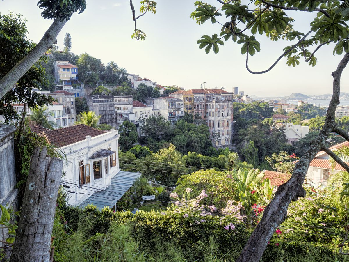 An aerial view of Santa Teresa in Rio de Janeiro. There are buildings and many gardens.