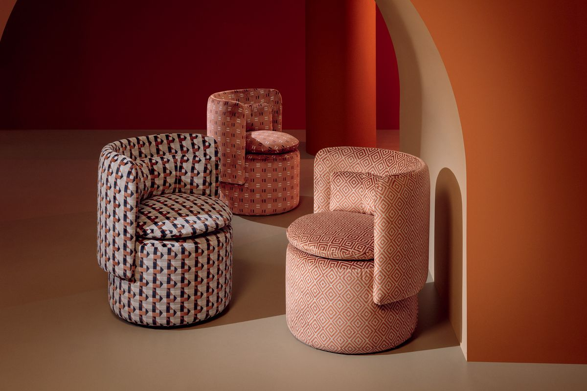 Chairs upholstered with patterned textile.