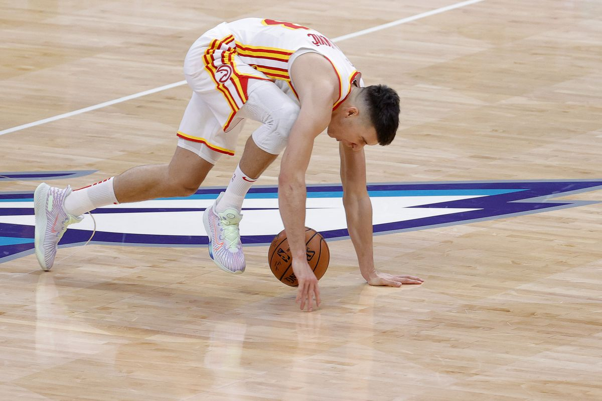 Bogdan Bogdanovic of the Atlanta Hawks goes to the floor with an injury during the second quarter of their game against the Charlotte Hornets at Spectrum Center on January 09, 2021 in Charlotte, North Carolina.