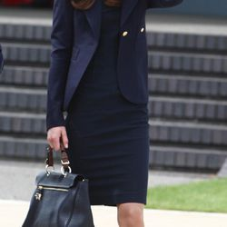 Leaving for a tour of Canada with Prince William in a Roland Mouret dress on June 30th, 2011. Her handbag is Mulberry.