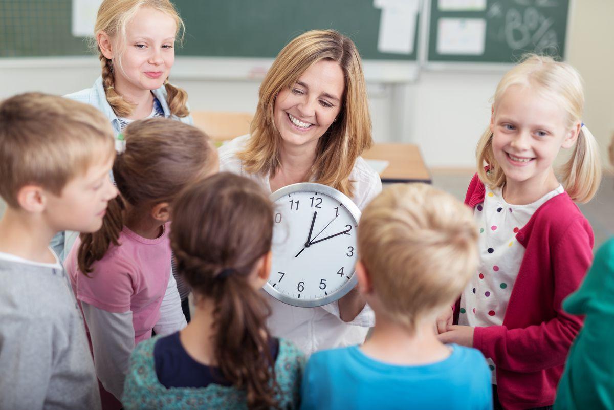 A preschool teacher, teaching