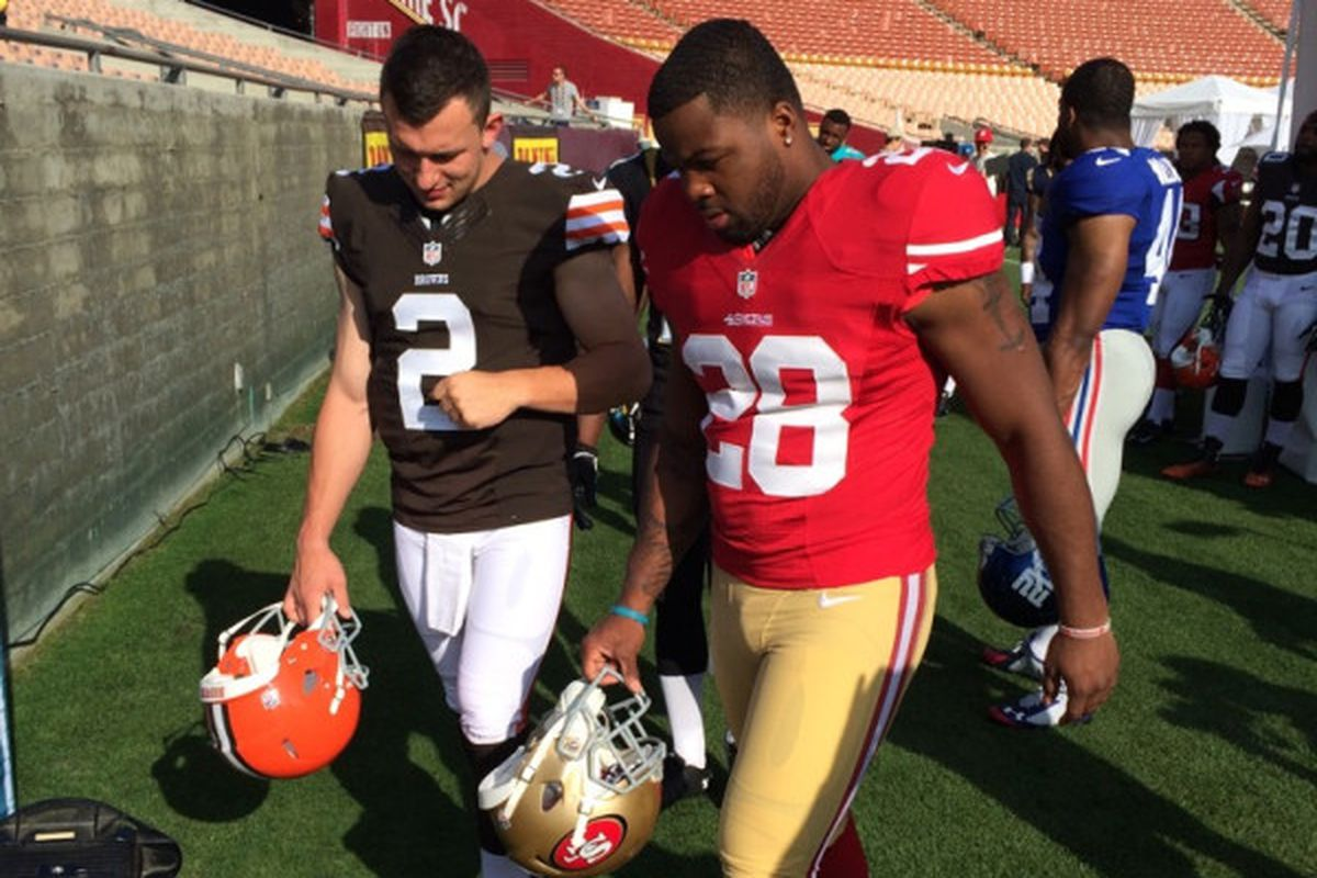 Johnny Manziel in full Browna uniform and pads with Carlos Hyde.