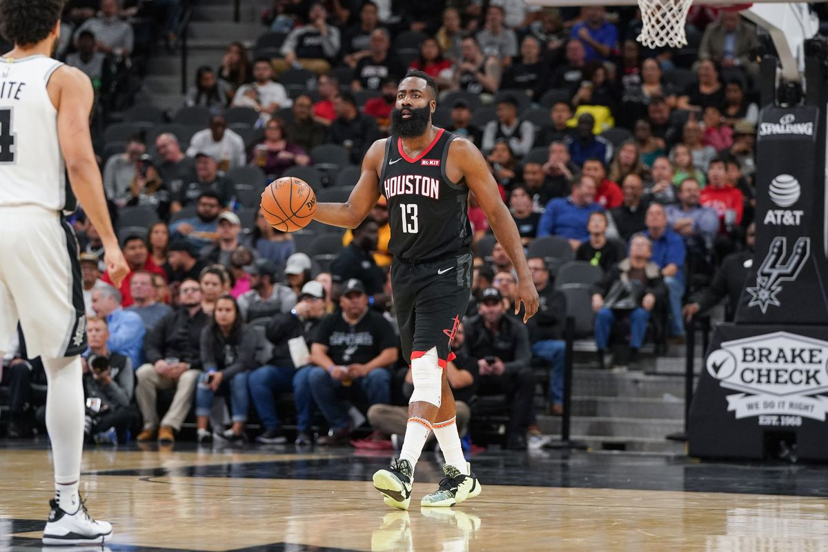 Houston Rockets guard James Harden brings the ball up in the second half against the San Antonio Spurs at the AT&T Center.