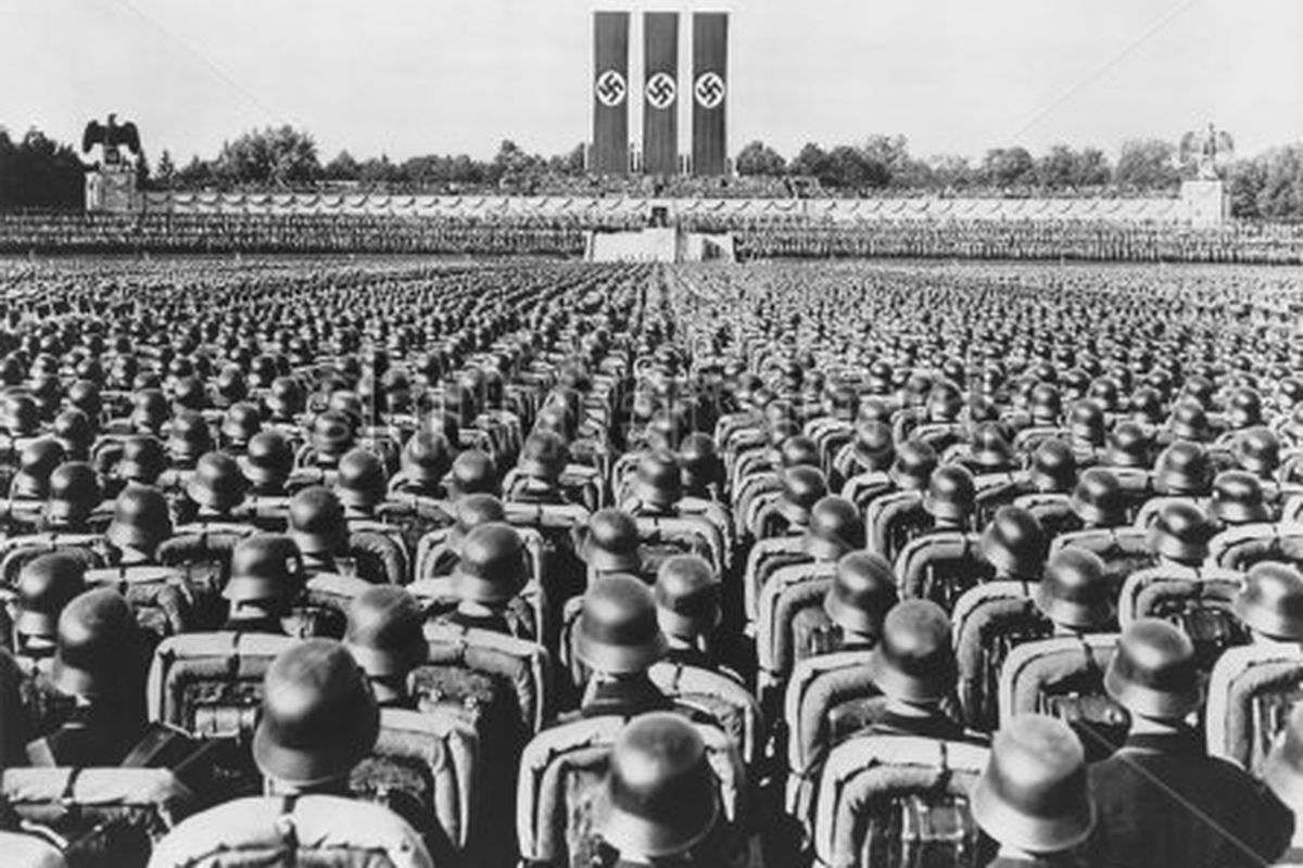 Nearly 100,000 Nazi storm troopers are gathered at Luitpold arena to listen to a 1933 speech by Adolf Hitler on 'Brown Shirt Day.'