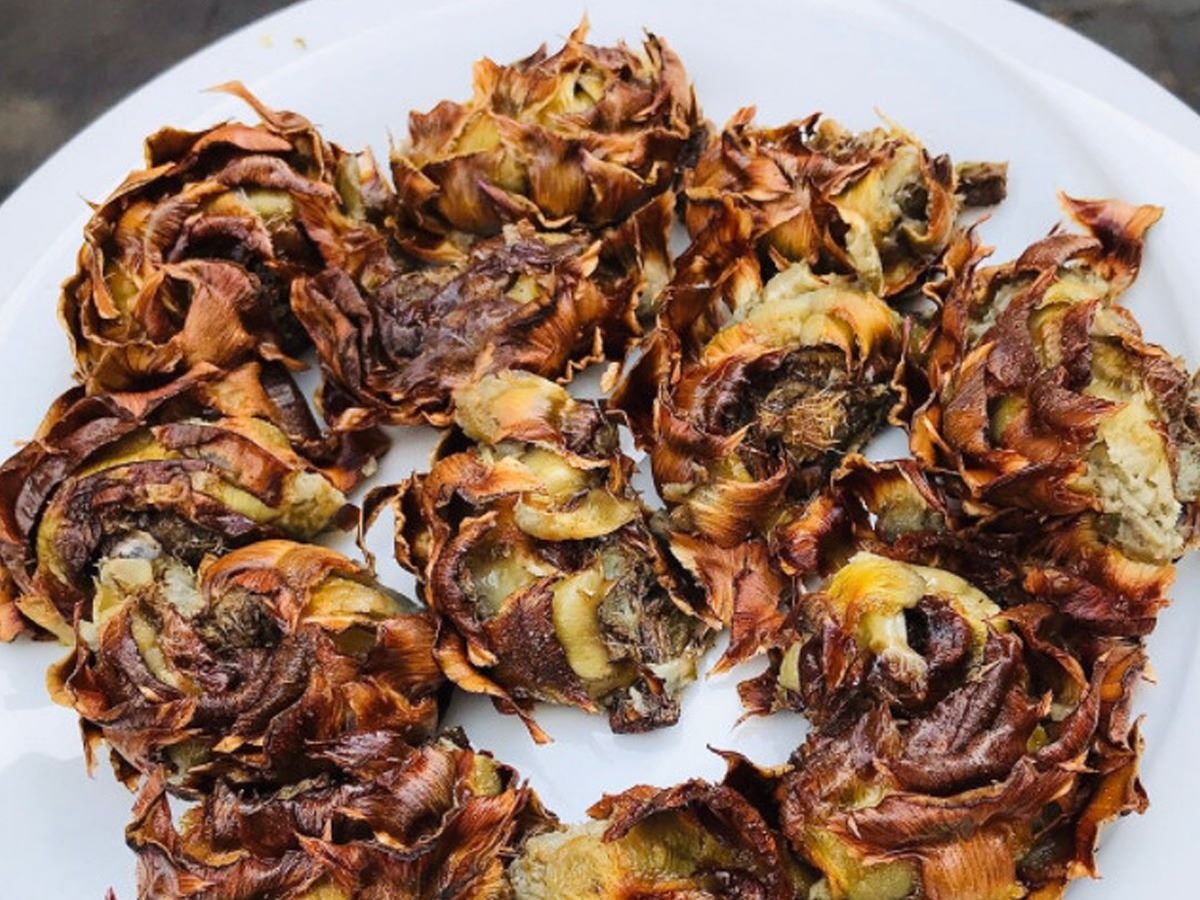 A bunch of fried artichokes on a white plate