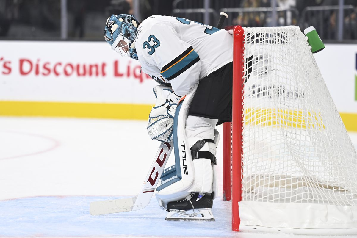 Adin Hill #33 of the San Jose Sharks tends net during the first period against the Vegas Golden Knights at T-Mobile Arena on September 26, 2021 in Las Vegas, Nevada.