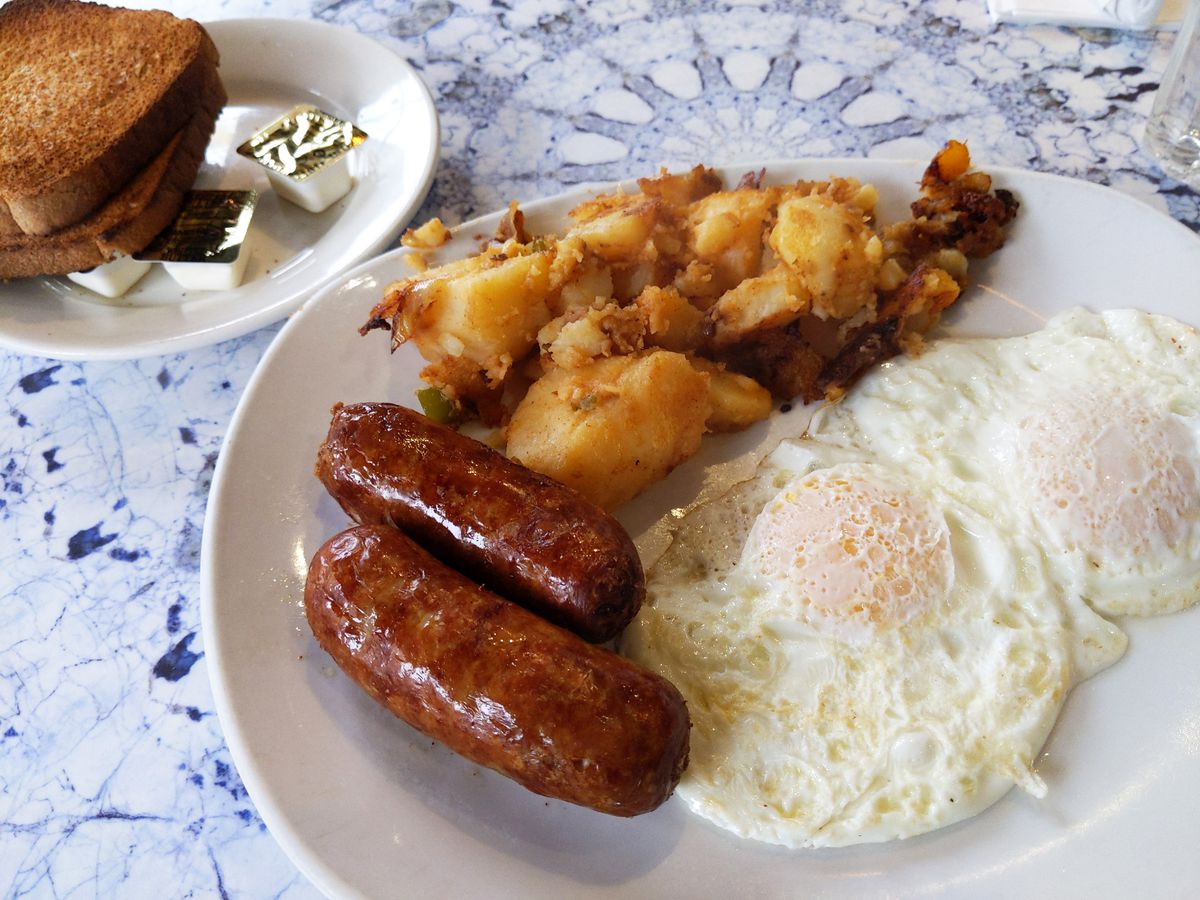 Two fried eggs, two plump sausages, to slice of toast, and a humongous pile of fried potatoes.