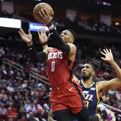 Houston Rockets guard Russell Westbrook (0) drives to the basket past Utah Jazz center Tony Bradley during the first half of an NBA basketball game, Sunday, Feb. 9, 2020, in Houston.