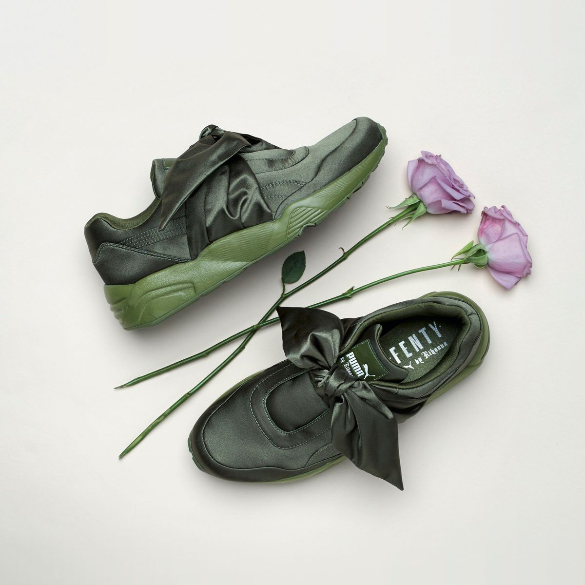 Green sneakers with satin bow laces