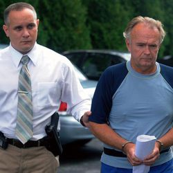 In this Monday, Sept. 13, 2012 photo, The Rev. Arthur Burton Schirmer, 62, right, is led into district court by Pennsylvania State Trooper Bill Skotleski in Tannersville, Pa.  Schirmer is accused of killing his wife and staging a car accident in July 2008 to cover up the murder. On Friday, Sept. 28, 2012 he was charged in the death of his first wife, Jewel, in 1999.
