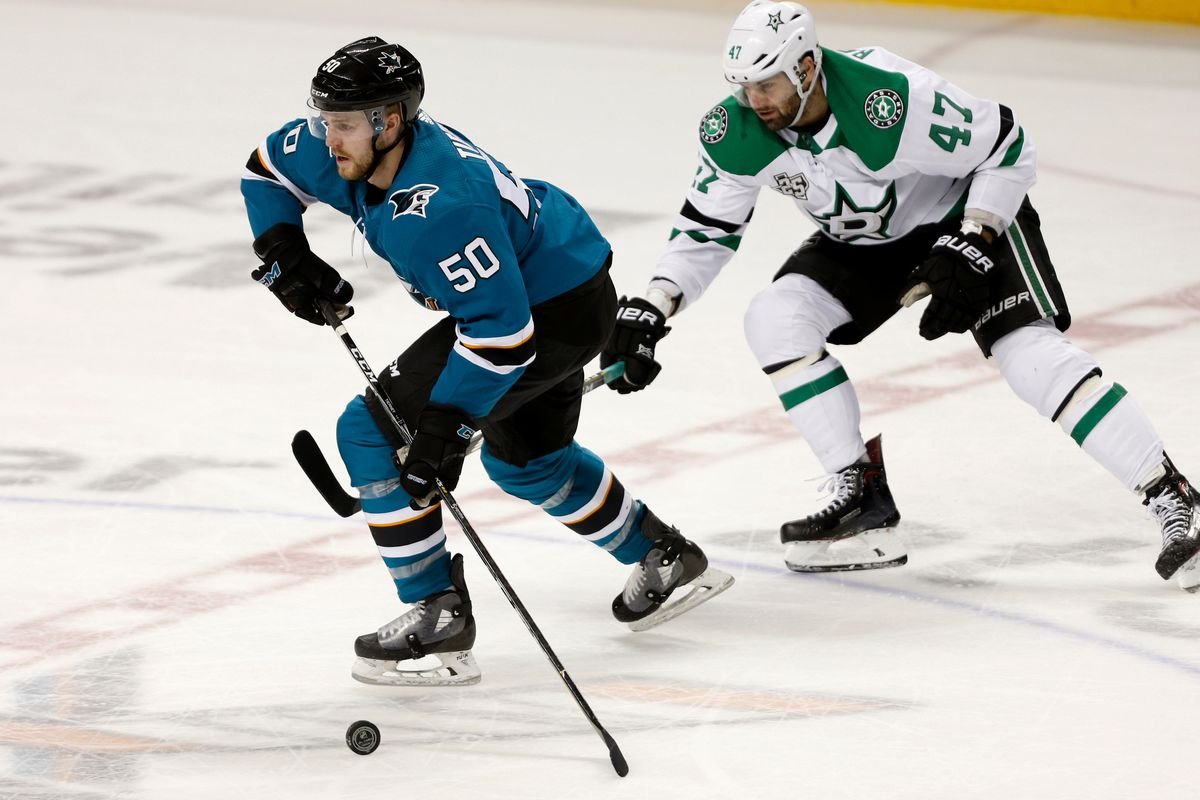 Feb 18, 2018; San Jose, CA, USA; San Jose Sharks center Chris Tierney (50) passes the puck against the Dallas Stars in the third period at SAP Center at San Jose.