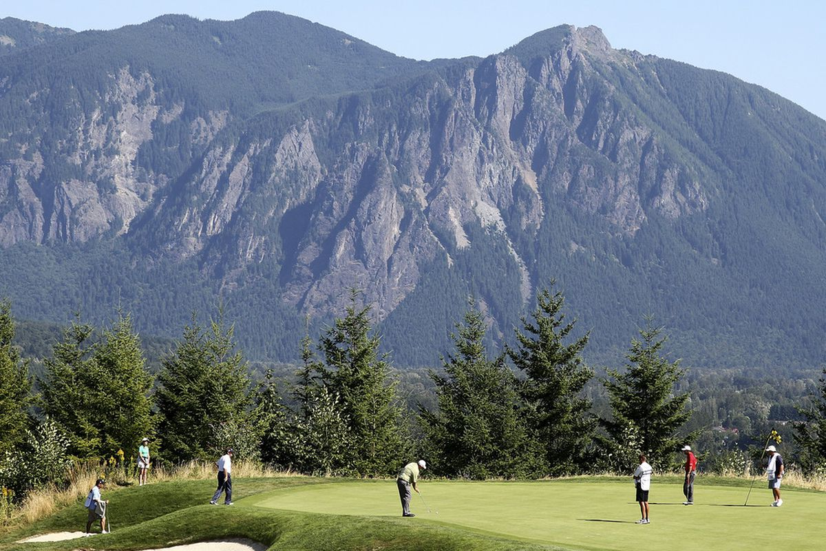 SNOQUALMIE, WA - AUGUST 27:  Mark Calcavecchia (C) putts on the 13th hole during the second round of the Boeing Classic at TPC Snoqualmie Ridge on August 27, 2011 in Snoqualmie, Washington. (Photo by Otto Greule Jr/Getty Images)