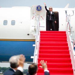 U.S. Secretary of State Hillary Rodham Clinton, center, waves as she departs Halim Perdanakusuma International Airport in Jakarta, Indonesia, Tuesday, Sept. 4, 2012.