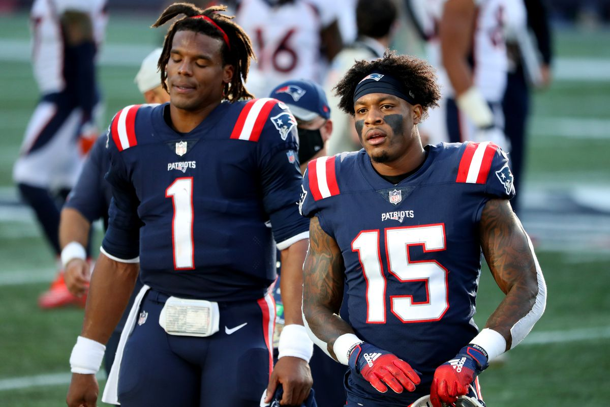 N'Keal Harry #15 of the New England Patriots and Cam Newton #1 look on after the game against the Denver Broncos at Gillette Stadium on October 18, 2020 in Foxborough, Massachusetts.