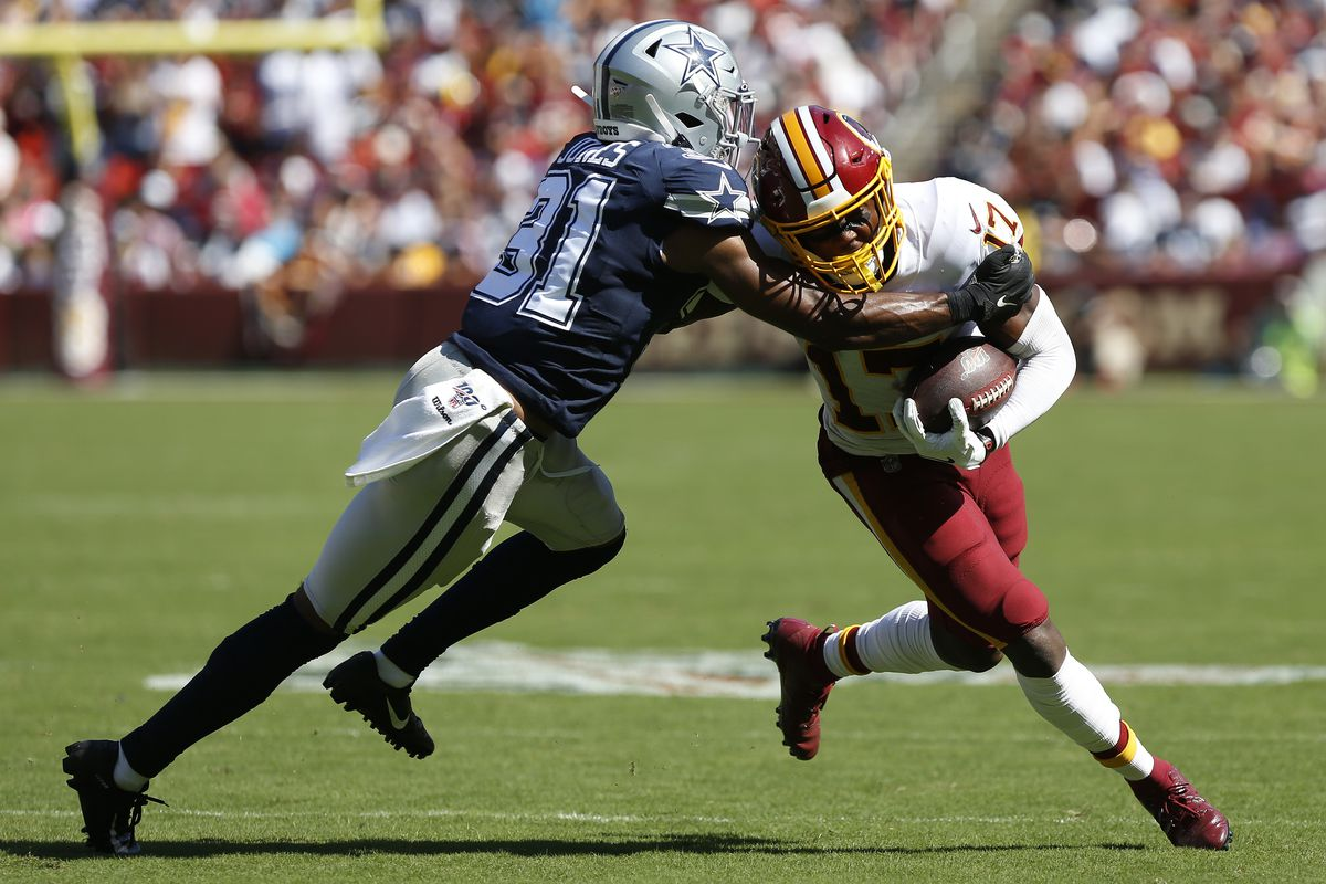 Washington wide receiver Terry McLaurin runs with the ball as Dallas Cowboys cornerback Byron Jones defends in the third quarter at FedExField.